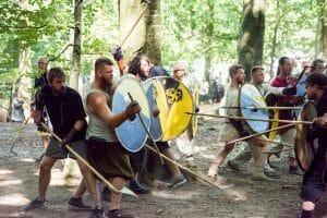 Viking reenactors fighting at the Moesgård Viking Moot in Aarhus