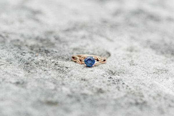 Light blue sapphire ring with rose gold band