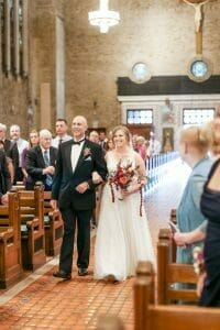 Bride walking down aisle in wedding in St. Patrick's Church in Philadelphia
