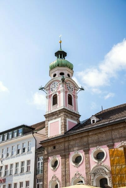 Pink clock tower in Innsbruck