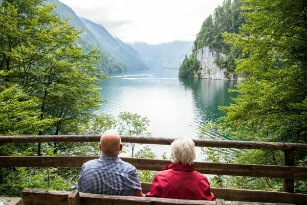 Elderly couple sitting by Lake Konigssee