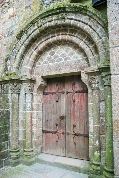 Red wooden door on Mont Saint-Michel