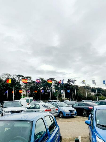 Parking lot with international flags in Pornic, France