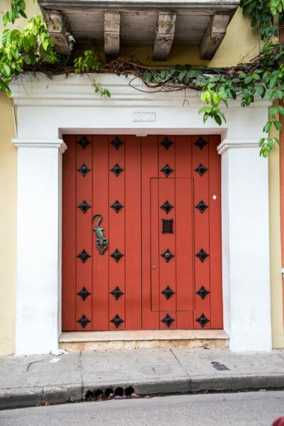 Red wooden door in Cartagena
