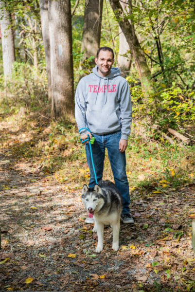 Walking in the forest with a husky