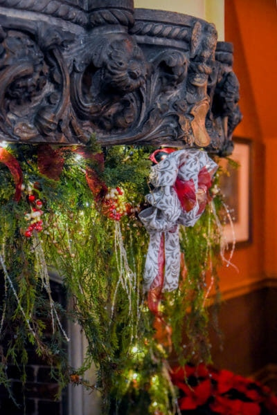 Christmas garland on a historic fireplace