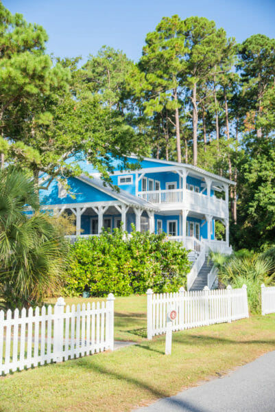 Bright blue beach house with white picket fence on Daufuskie Island