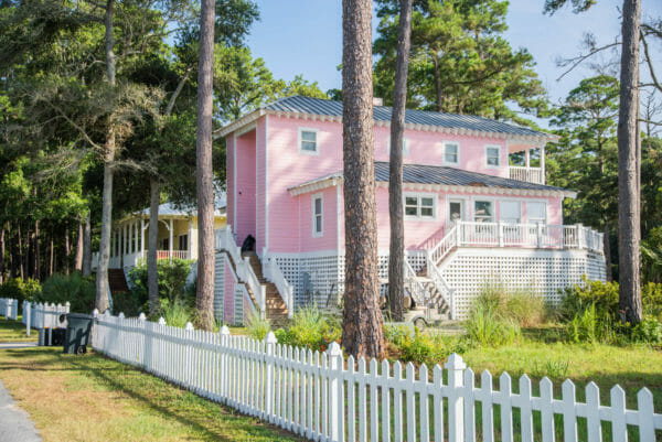 Light pink beach house with white picket fence on Daufuskie Island