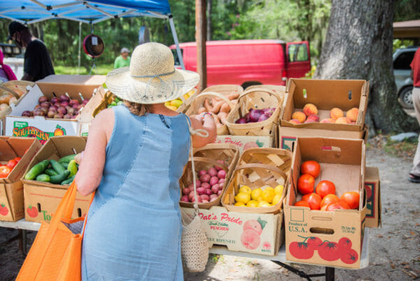 Woman getting produce at farmer's market on Daufuskie Island