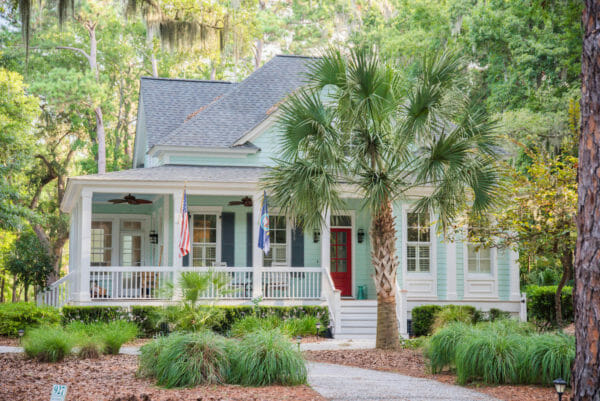Turquoise beach house with palm tree on Daufuskie Island