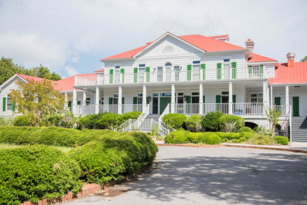 White house with green shutters and light red roof on Daufuskie Island