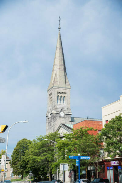 Stone church with tall tower in Plattsburgh, NY