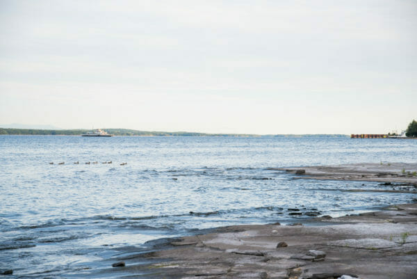 View of Lake Champlain with boat on water