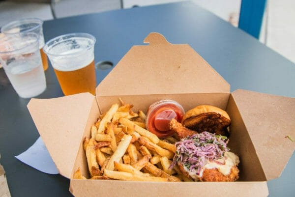 Fried chicken sandwich and French fries and beer at Zero Gravity brewery