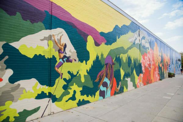 Colorful mural of women hiking in Burlington, VT