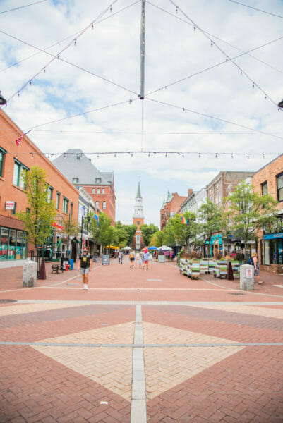 Church Street with stores and people walking in Burlington, VT