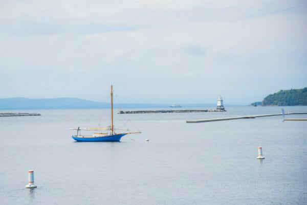 Blue sailboat on Lake Champlain in Burlington, VT