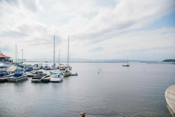 Boats moored at a dock on Lake Champlain in Burlington, VT