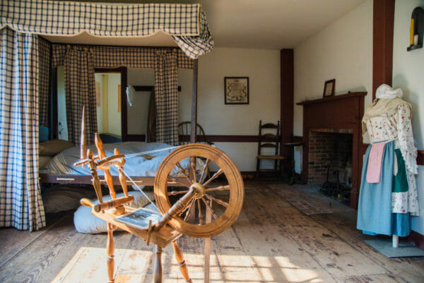 Bedroom with spinning wheel in Ethan Allen home