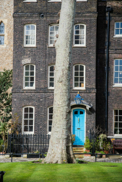 Black brick building with a blue door at the Tower of London