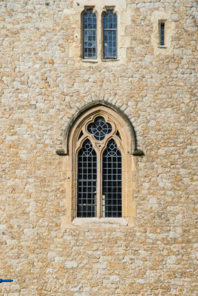 Stone tower with decorative arched windows