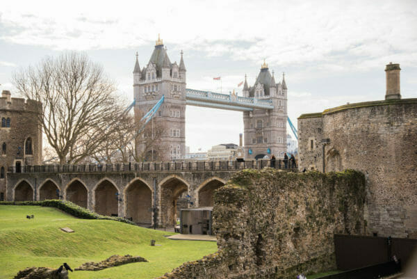 Tower Bridge behind a stone wall with arches