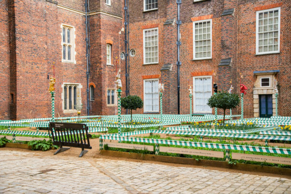 Renaissance style garden with green and white striped poles