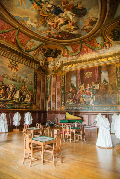 Room in Hampton Court with large paintings and painted ceiling