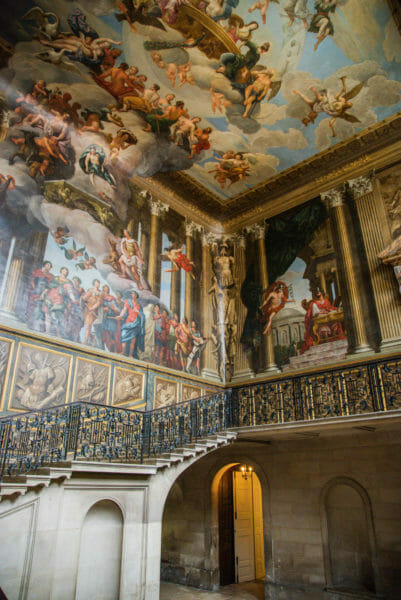 Large staircase with painted walls and ceiling at Hampton Court