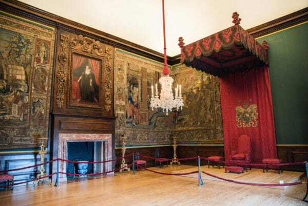 Throne room with red canopy at Hampton Court