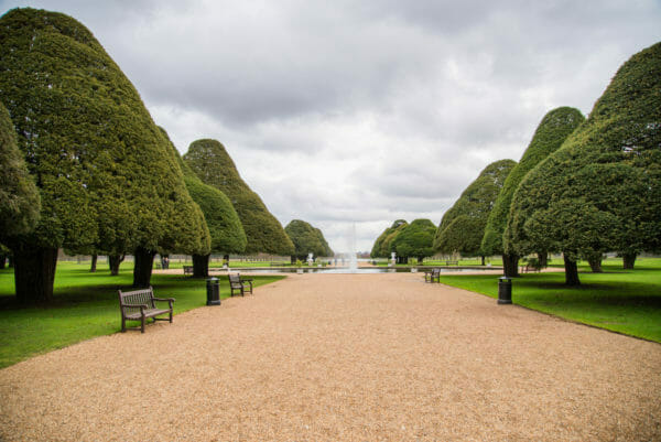 Hampton Court garden with fountain and large trees