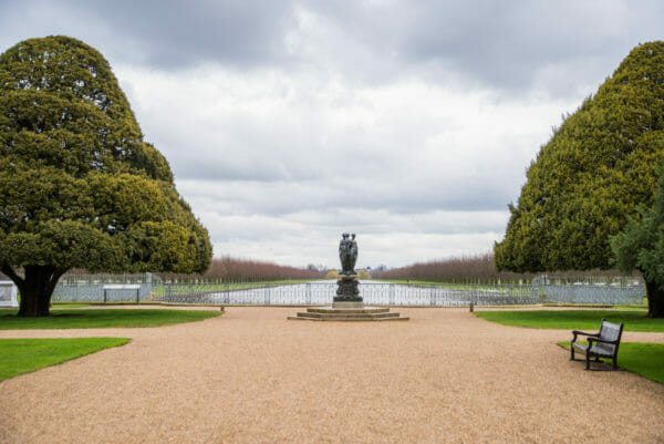Hampton Court garden with statue in front of a pond