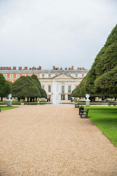 Back view of Hampton Court with fountain and trees