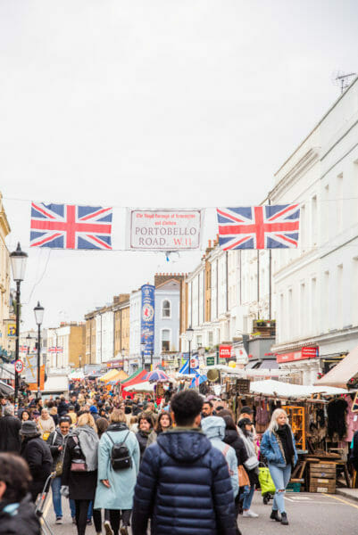 Portobello Road banner across busy street in Notting Hill