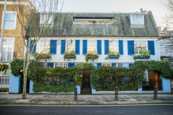 Blue house with dark blue shutters in Notting Hill