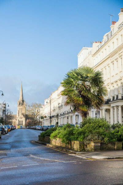 White townhouses and a stone church in Notting Hill