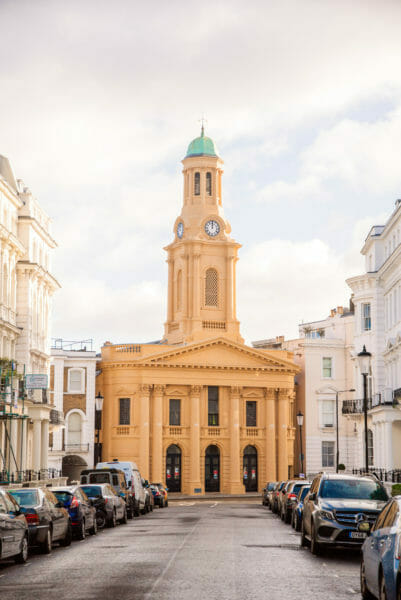 Orange church with a clock tower in Notting Hill