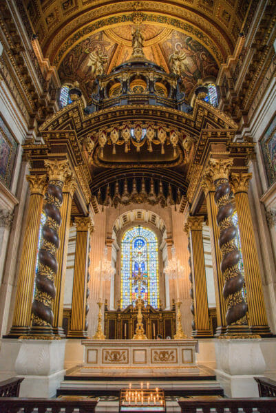Gold altar and stained glass windows in St. Paul's Cathedral