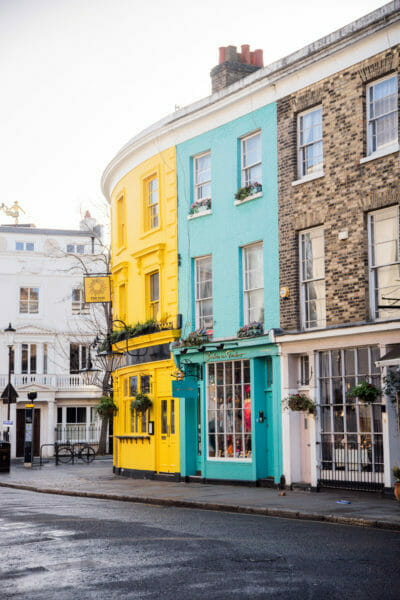 Teal and yellow curved building in Notting Hill