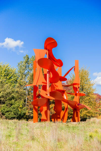 Large abstract orange statue at Meijer Gardens