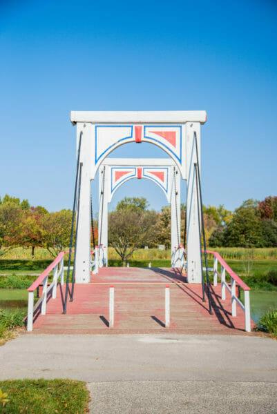 White footbridge in Windmill Island Gardens